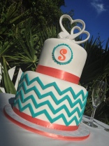 """Sara"" Contemporary coral and teal chevron wedding cake."