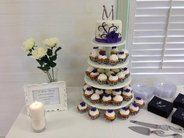 """Merideth""  Mini wedding cake with scrolling black pattern and purple flower."