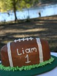 1st birthday football smash cake