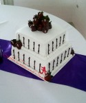 Alabama grooms cake with chocolate ganache drizzle and chocolate covered strawberries