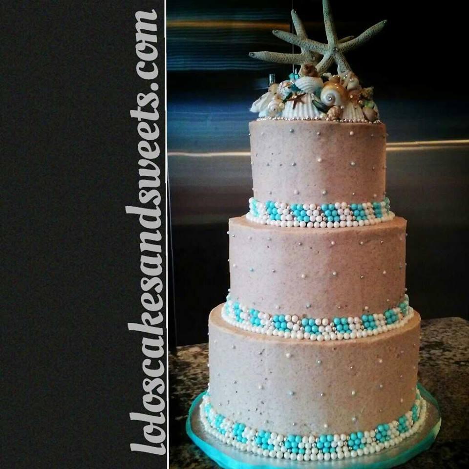 Cinnamon buttercream created a sandy look for this beach wedding.