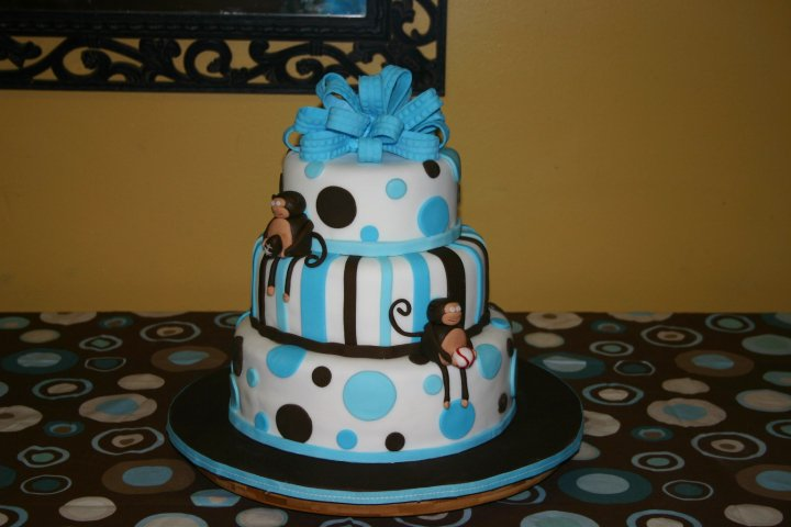 Sports themed baby shower cake in blue and brown feature sculpted gumpaste monkeys.  Feeds 65-70.  MSRP $250