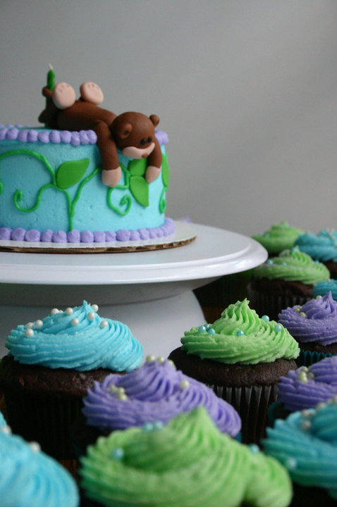 Blue Green And Purple Sculpted Monkey Smash Cake And Cupcakes