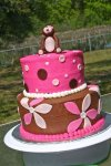 brown and pink flowers monkey baby shower cake