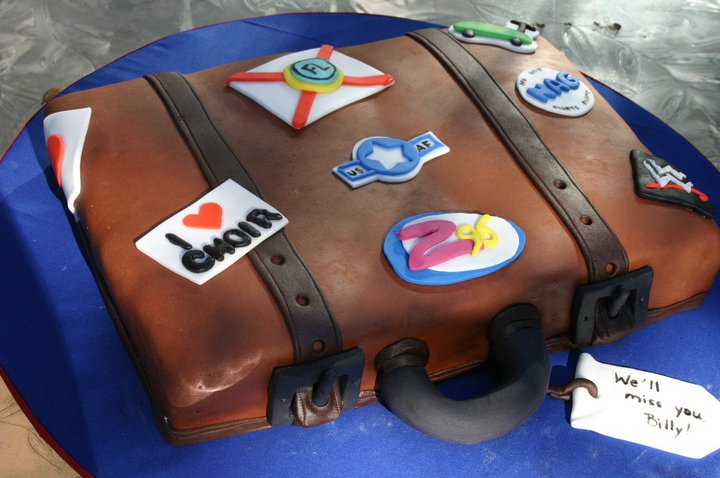 brown suitcase with stickers going away cake