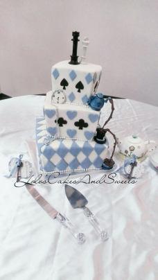 """""""Alice"""" Alice in Wonderland wedding cake complete with gumpaste tea cup, tea pot and top hat"""