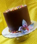 Chocolate ganached cake with jumbo sprinkles and wafer paper flower