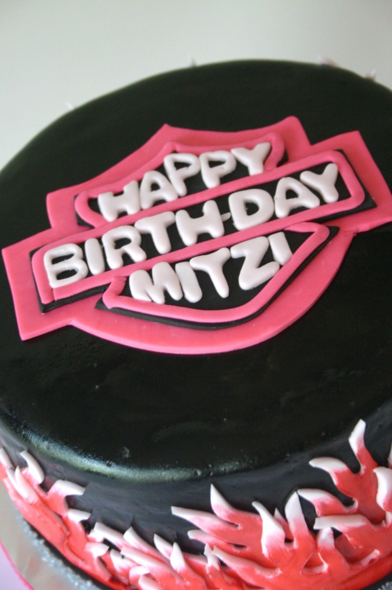 Close up of logo on Girly pink Harley-Davidson cake