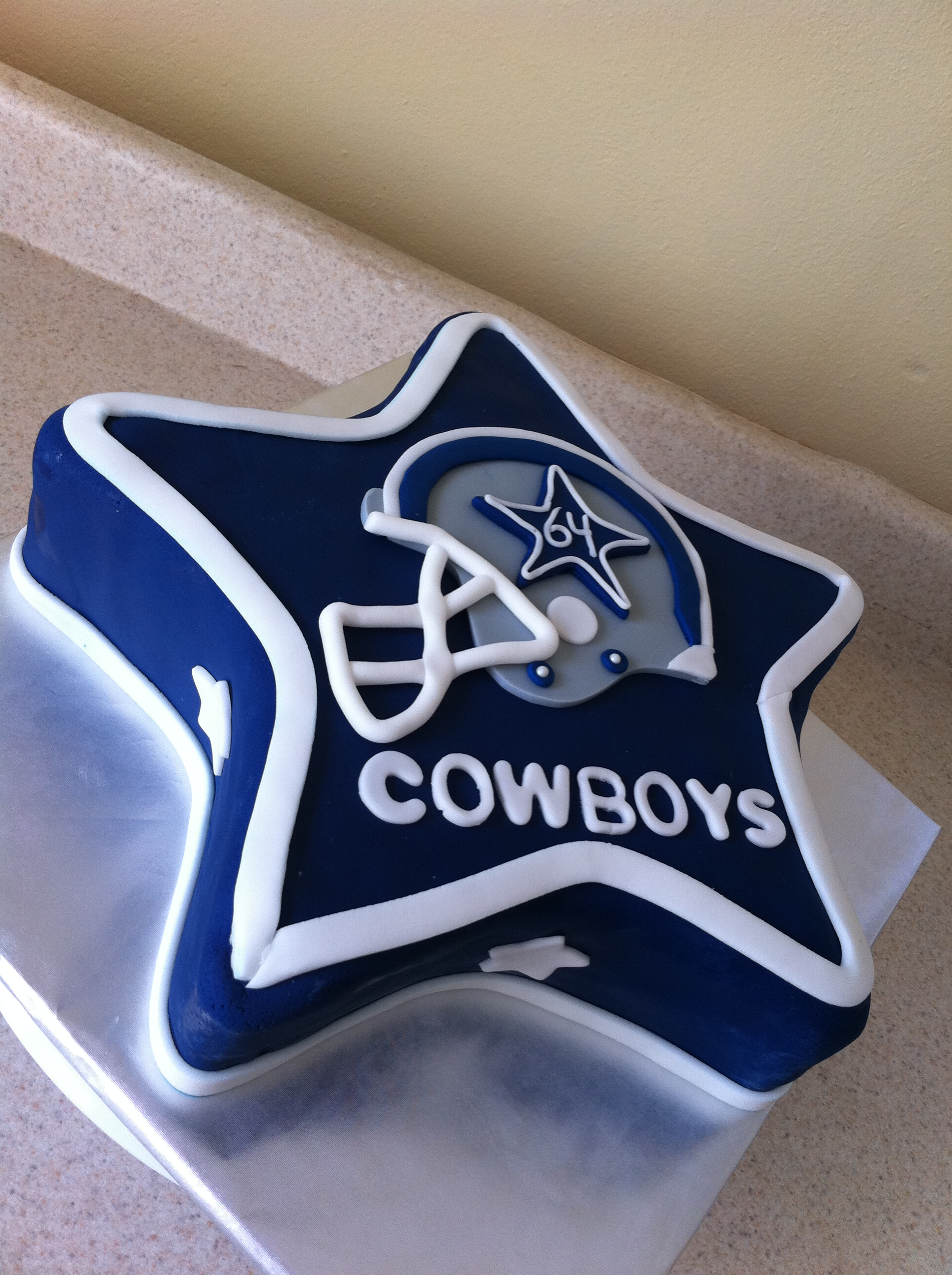 Dallas Cowboys themed birthday cake. Feeds 20-25. MSRP $100.