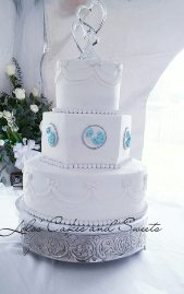 """Love Bird"" a classic white buttercream wedding cake with love dove brooches."