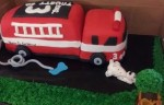 Sculpted fire truck birthday cake and decorated cake board. Feeds 20-25. MSRP $140