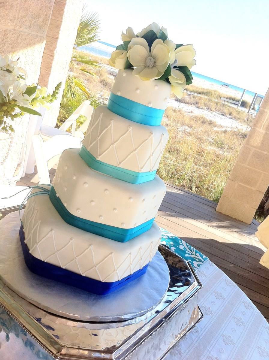 Hexagon blue ribbon wedding cake