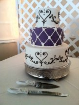 Ivory purple and brown lattice and scrolling wedding cake
