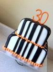 Orange black and white birthday cake
