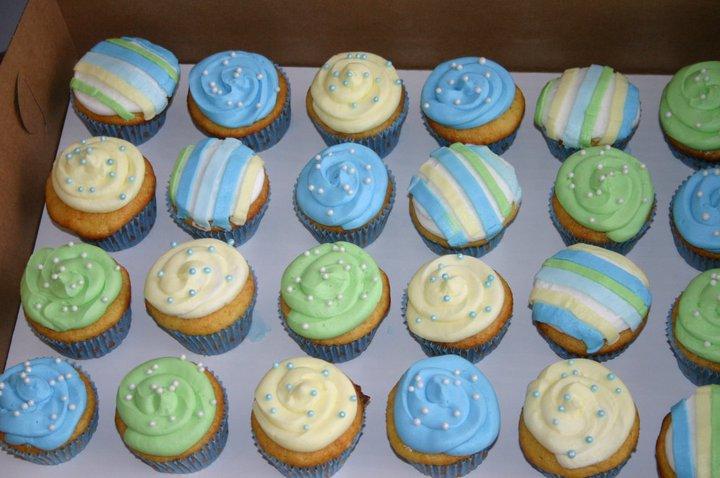 pastel green yellow blue polka dot and stripes 1st birthday cupcakes