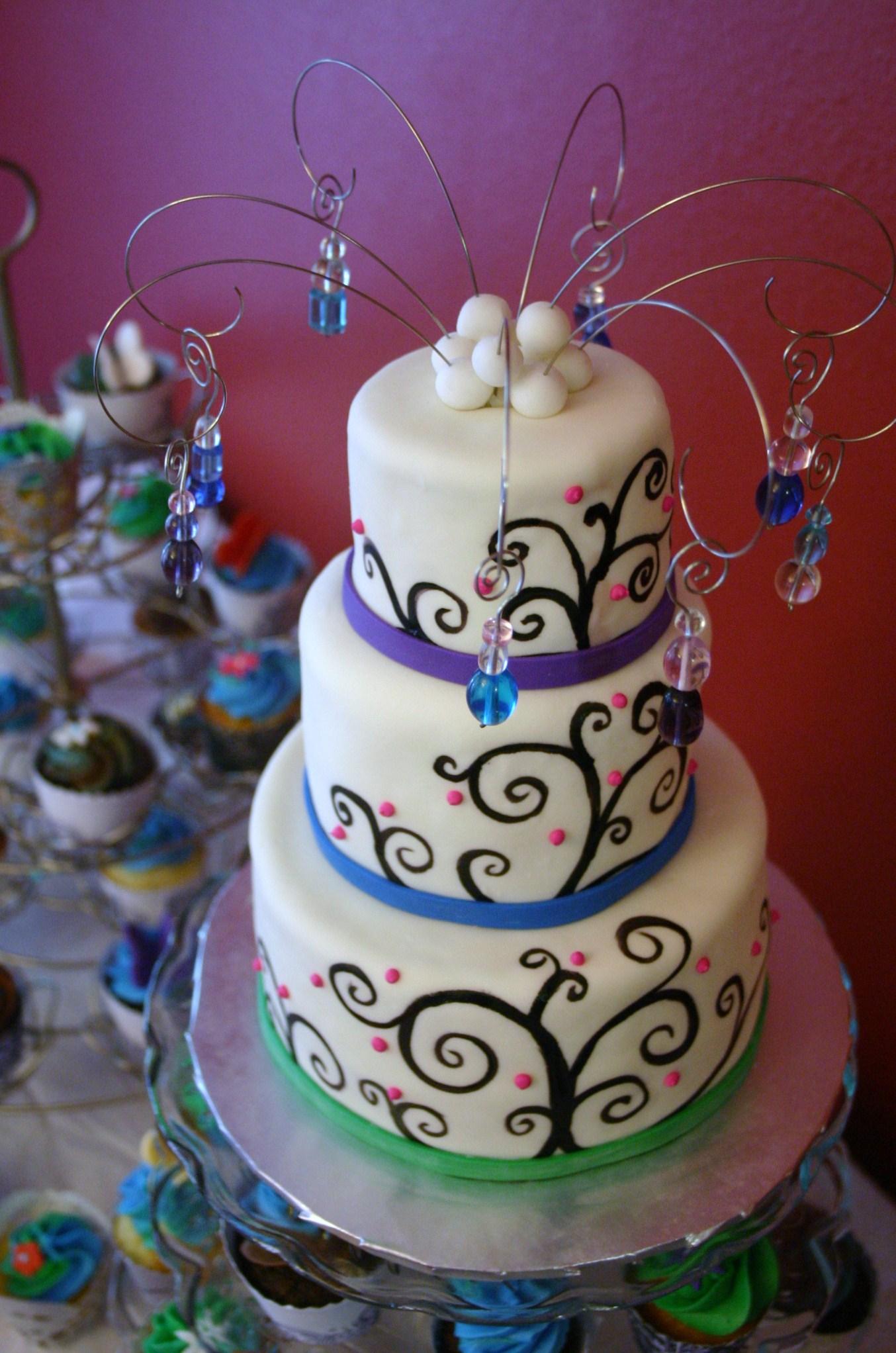 Peacock esque mini wedding cake