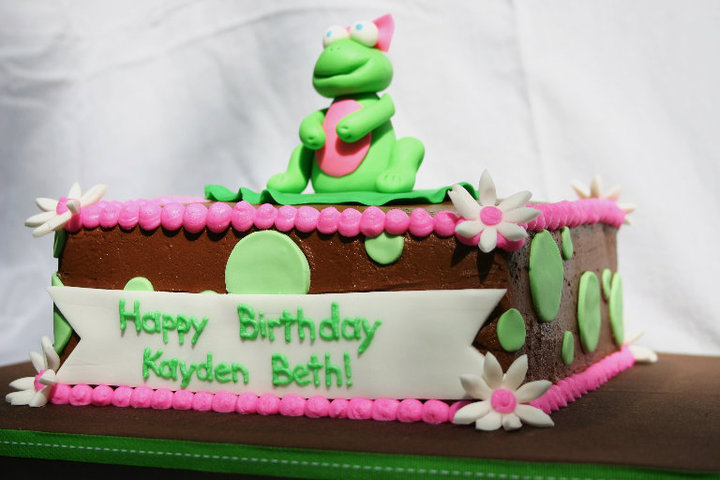 pink and brown frog birthday cake