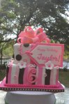 pink and brown stripes and polka dots birthday present cake