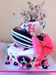 pink black and white topsy turvy 14 birthday cake