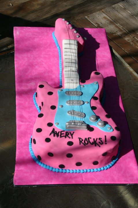 Pink, blue and black sculpted guitar birthday cake. Feeds 40-45. MSRP ...