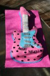 pink blue and black polka dotted sculpted guitar birthday cake