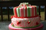 pink red and green Strawberry Shortcake birthday cake