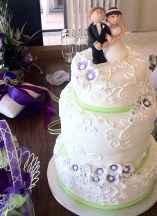 Purple green and white wedding cake