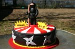 red and white rising sun ninja birthday cake