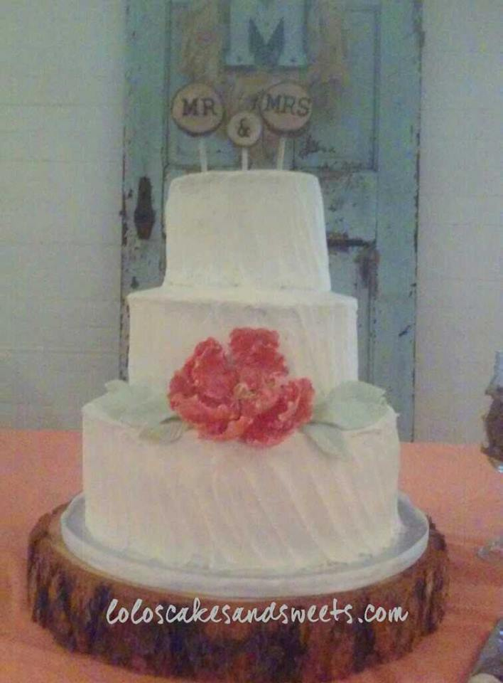 Rustic wedding cake with peony flower