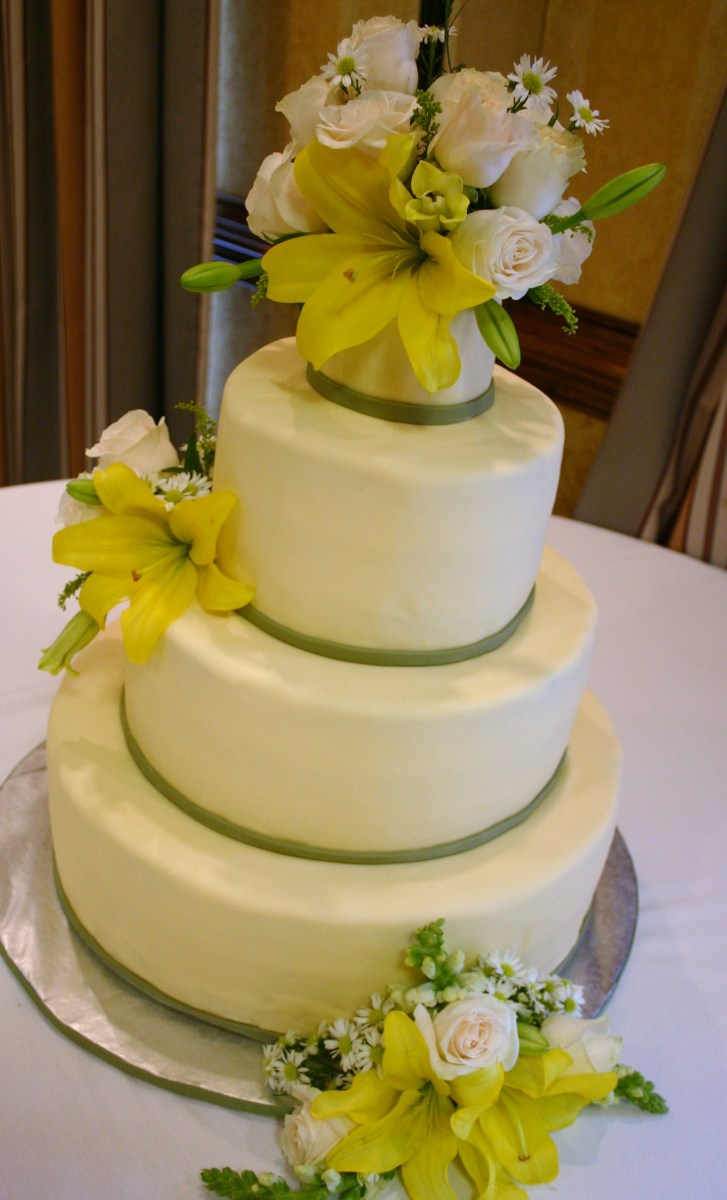 The Ciara buttercup yellow and sage green wedding cake