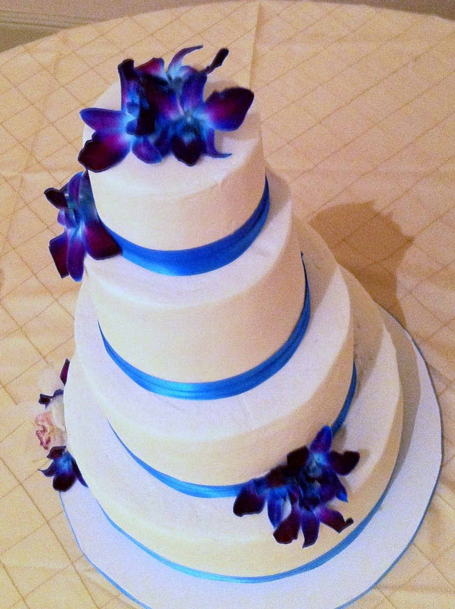 topaz blue, purple orchid and white wedding cake