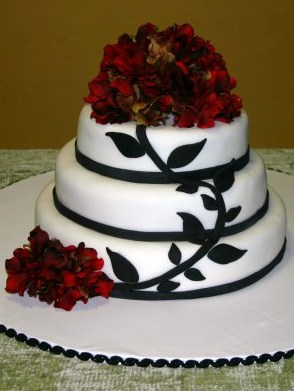 white and black vine with red hydrangeas wedding cake