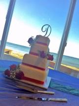 White and red rose wedding cake