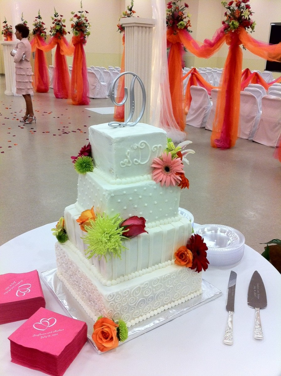 White on white square wedding cake with monogram