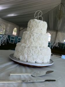 """Katie""  White swirl rose wedding cake.  Feeds 90-100.  MSRP $400"