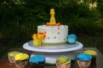 yellow blue and green jungle baby shower cake and cupcakes