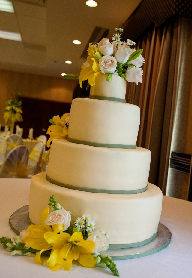 Buttercup yellow and sage green wedding cake