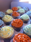 Orange, yellow, blue, green baby shower cupcakes