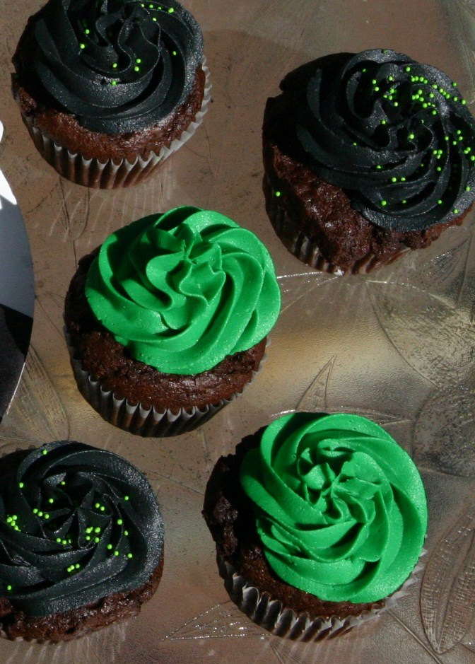 Green and black Ben 10 cupcakes