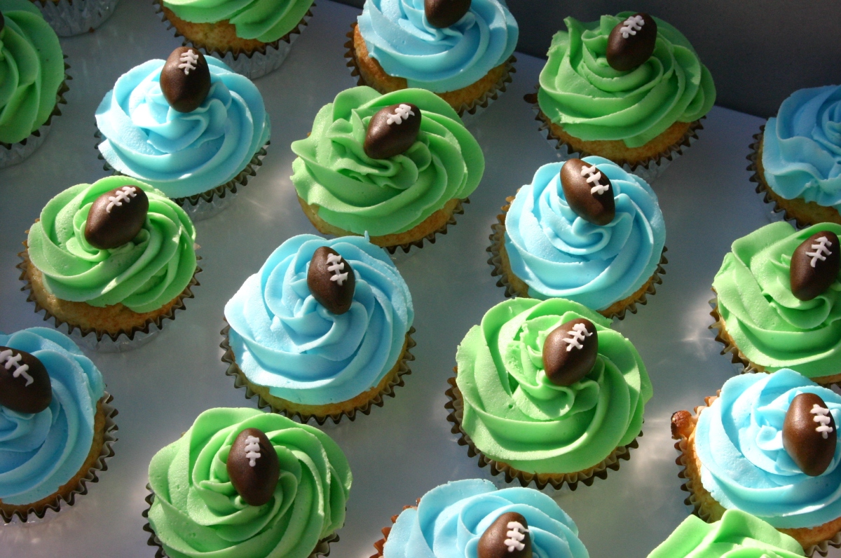 green and blue football cupcakes