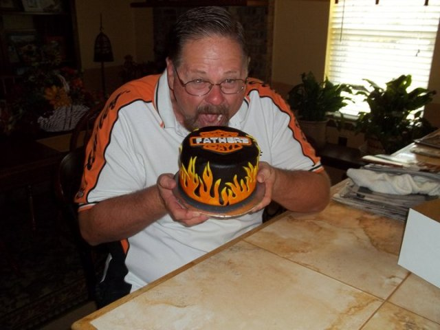 Happy customer eating Harley Fathers Day cake