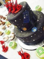 PI day wedding cake complete with spaceships of all different sorts, planets, stars, and cupcakes!
