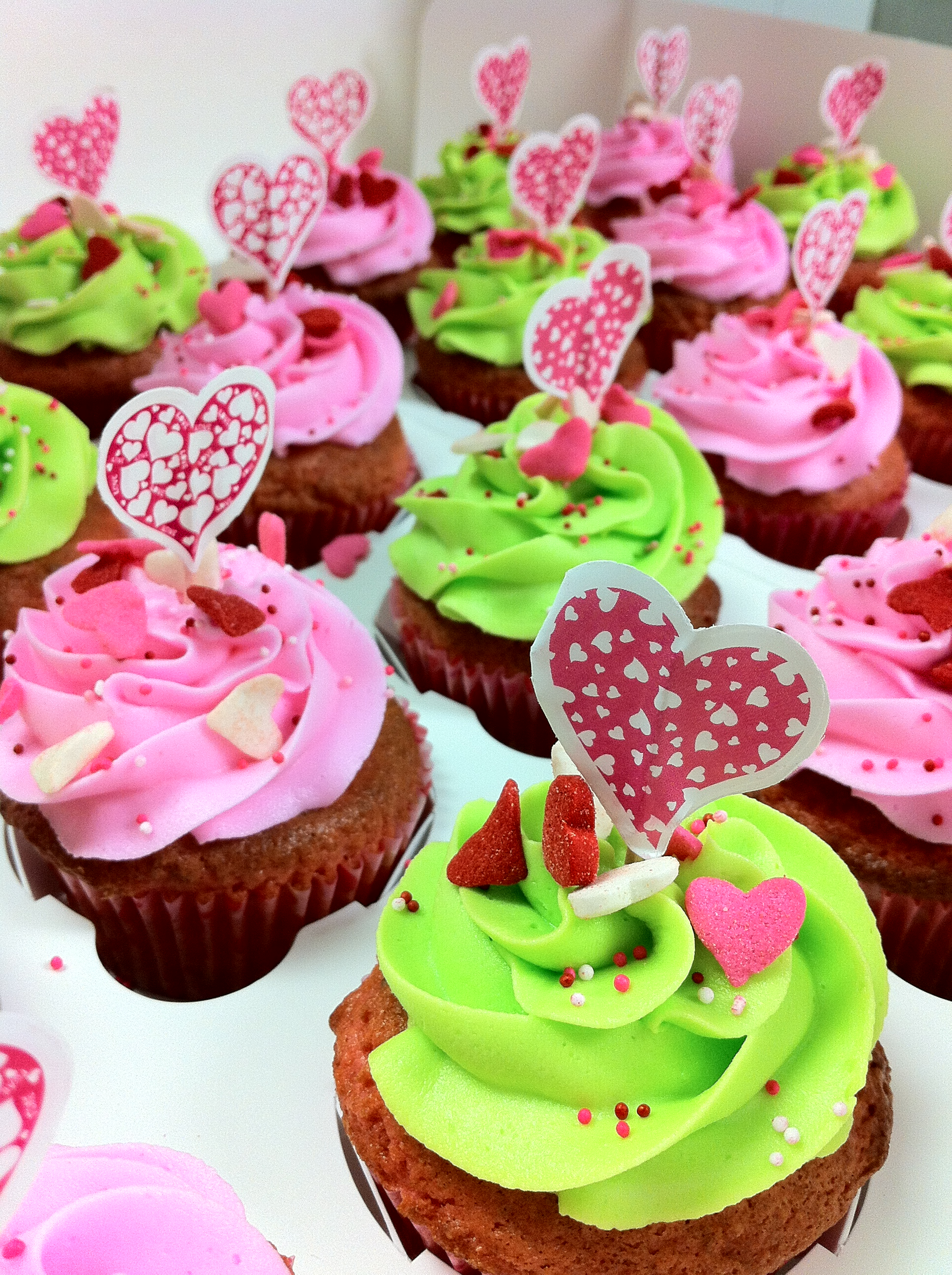 Pink and lime green heart cupcakes