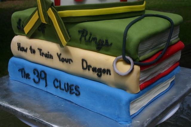 Close up of books birthday cake