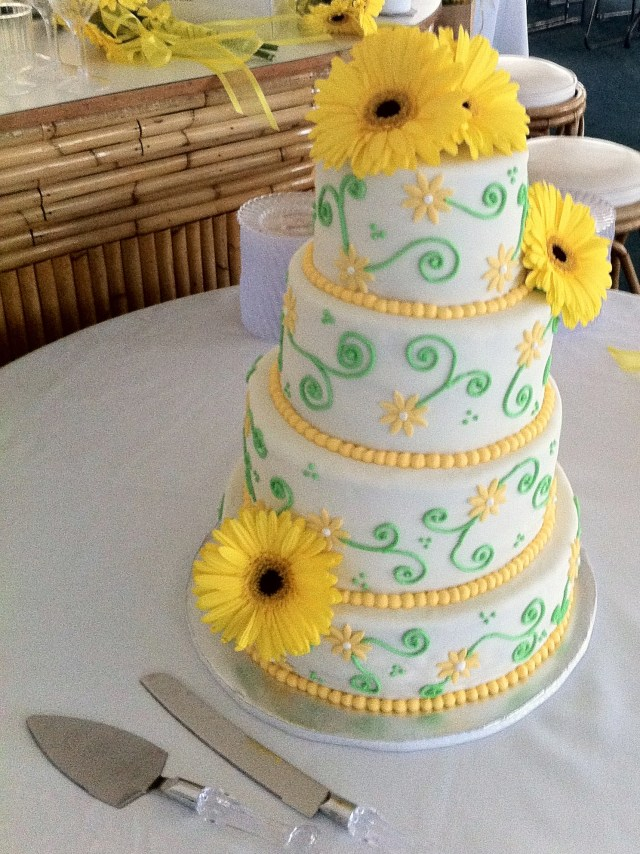 yellow daisy and green scroll wedding cake
