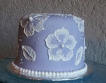 Brushed lace birthday cake with edible pearls. Feeds 15 MSRP $75