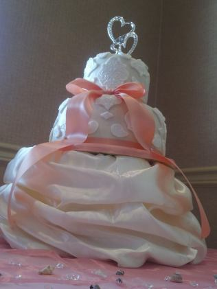 """Priscilla"" Faux lace cake paired with a satin bow and a satin cake dress."