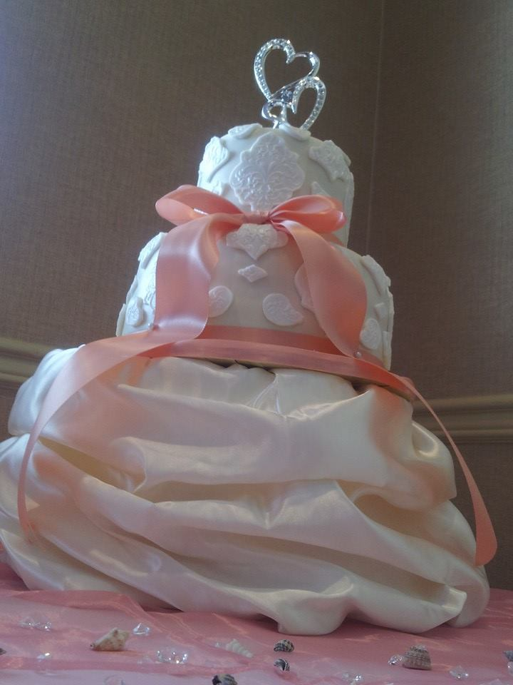 """""""Priscilla"""" Faux lace cake paired with a satin bow and a satin cake dress."""