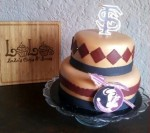 Florida State grooms cake with gumpaste topper and front logo.