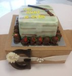 The Hunt is Over grooms cake with chocolate covered strawberry boarder.